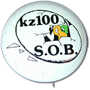 "wooden plaque with a cutout of the Z100 buzzard and the Z100 logo. Inscription reads ""For those who give the rewards are high. Here's yours"""